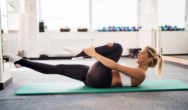 Woman performing pilates.