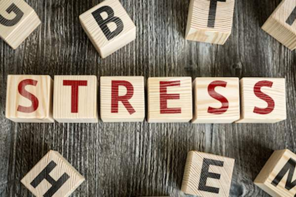 Stressful words concept, stress spelled out in letter blocks.