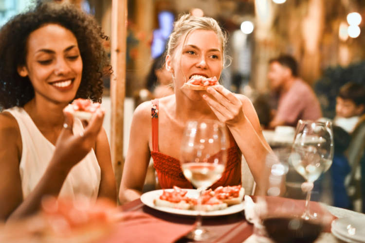 two women eating dinner together