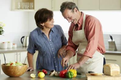 Couple prepares foods as part of a high potassium diet.