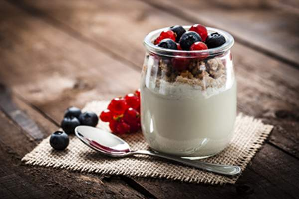 Yogurt with berries and granola.