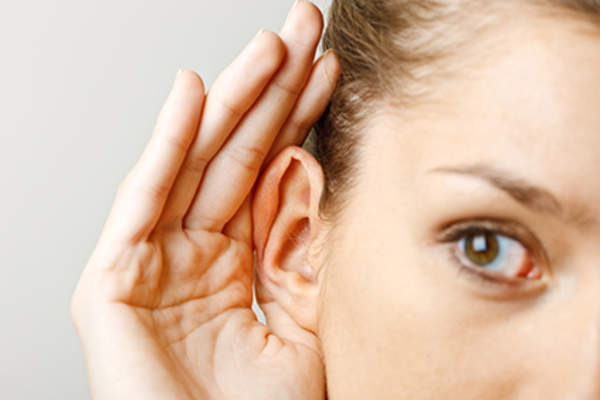 Woman experiencing hearing loss caused by RA.