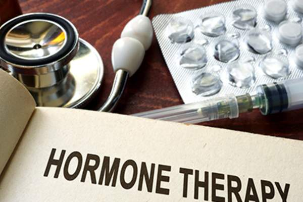 Book with words hormone therapy on a table