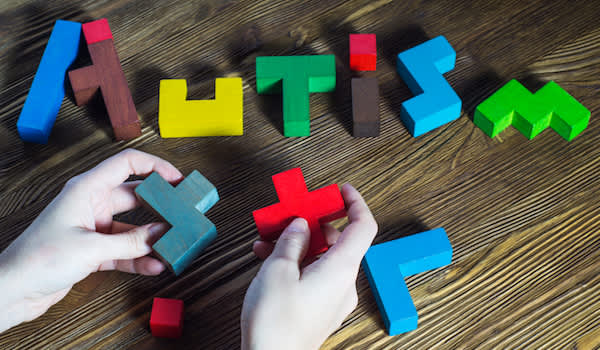 Autism spelled out with artsy wood letter blocks.