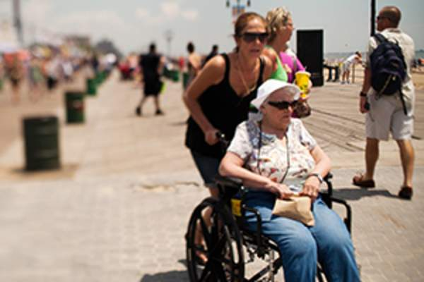 woman in wheelchair on boardwalk image