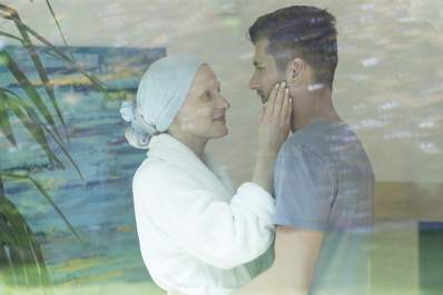 Couple in intimate embrace after cancer.