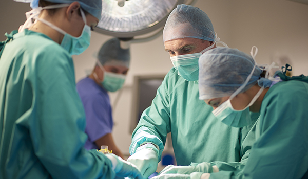 Surgical team operating on a patient