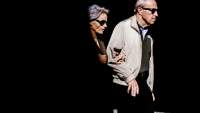 two seniors walking wearing sunglasses