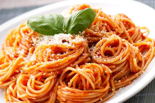 Spaghetti with tomato sauce on a white plate
