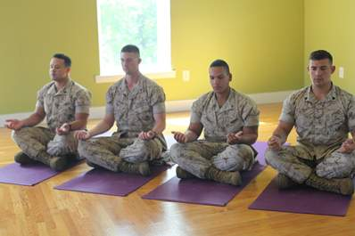 Four marines meditating.
