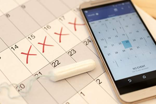 Menstrual cycle tracking on calendar and phone.
