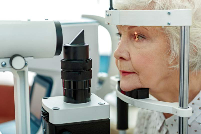 senior woman getting Dilated Eye Exam