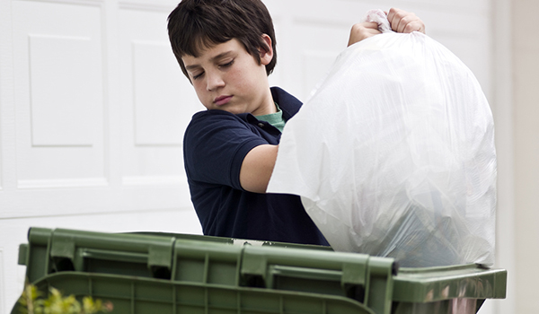 Boy taking out the trash