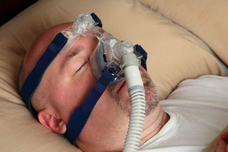 person wearing CPAP machine