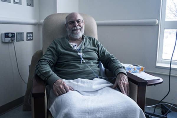 Man receiving chemotherapy treatment.