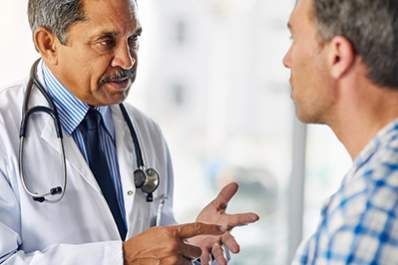 A doctor talking to a patient about important diabetes tests.