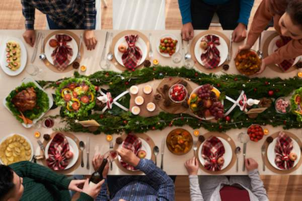 Gathering at table for christmas dinner