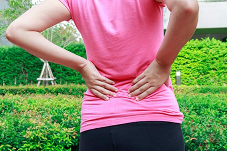 Woman with lower back pain.