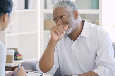 Senior man talking to doctor about depression.