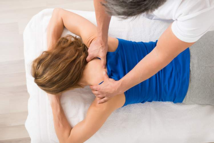 Woman receiving massage.