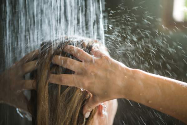 woman washing hair in shower.
