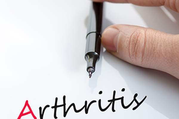Arthritis awareness pen in hand.