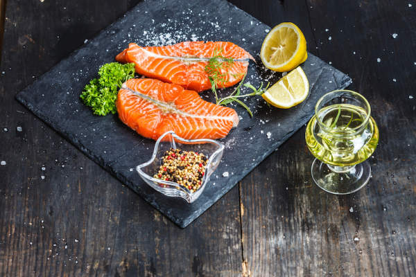 Salt peper coriander olive oil and lemon with salmon steaks