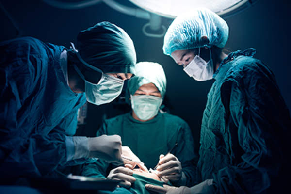 Surgeons performing an operation.