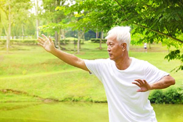 An active senior outside exercising.