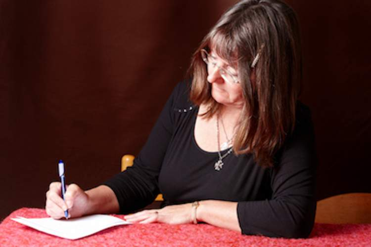 Woman writing letter.