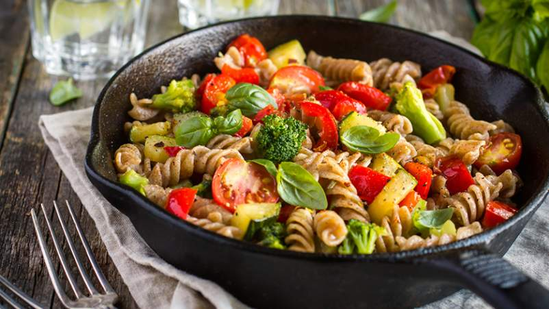 Whole wheat pasta with fresh vegetables.