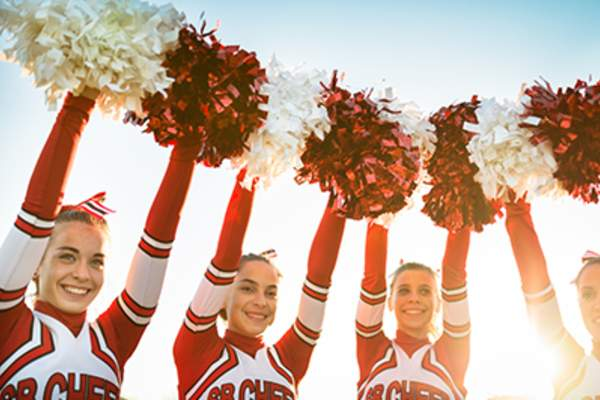 Cheerleaders with pom-poms.