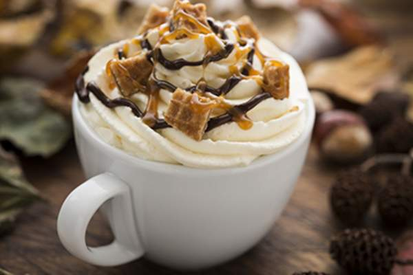 Coffee with caramel sauce, chocolate sauce, and whipped cream on top.