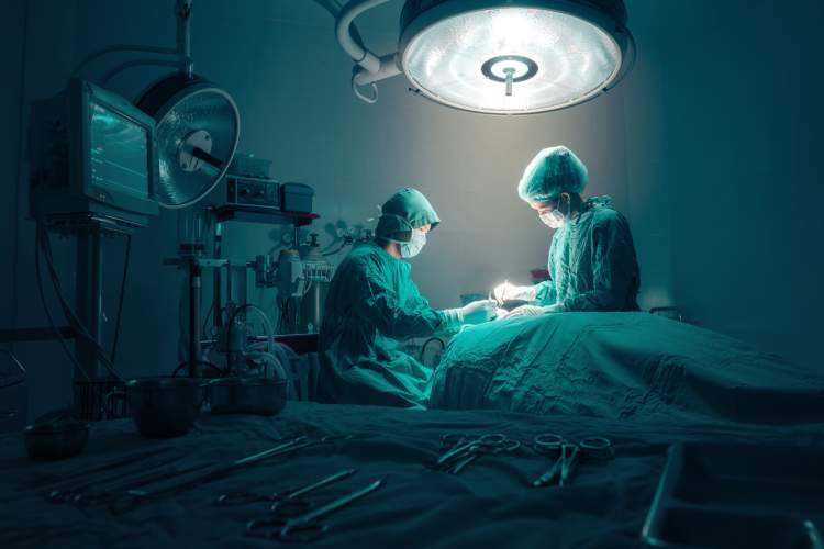 Surgeons operating on a patient.