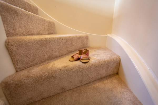 Pair of shoes on intimidating stairs.