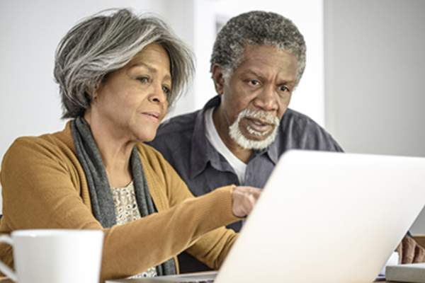 Skeptical couple doing research online.