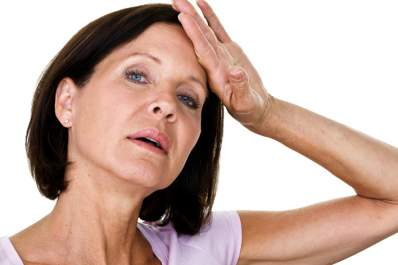 Menopausal woman having a hot flash.