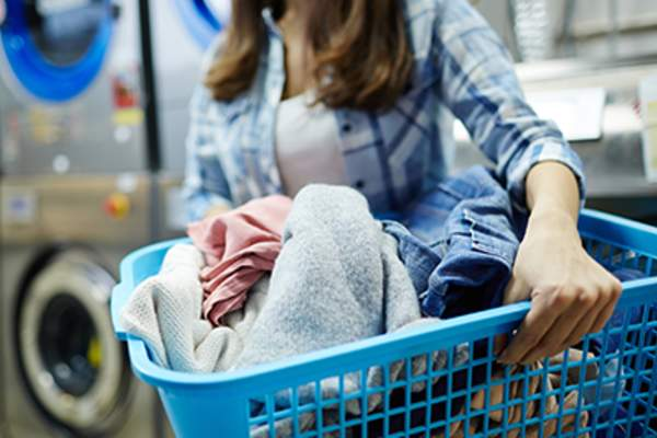 Clothes in laundry basket.