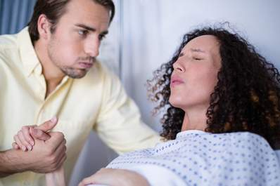 Man helping woman during labor.
