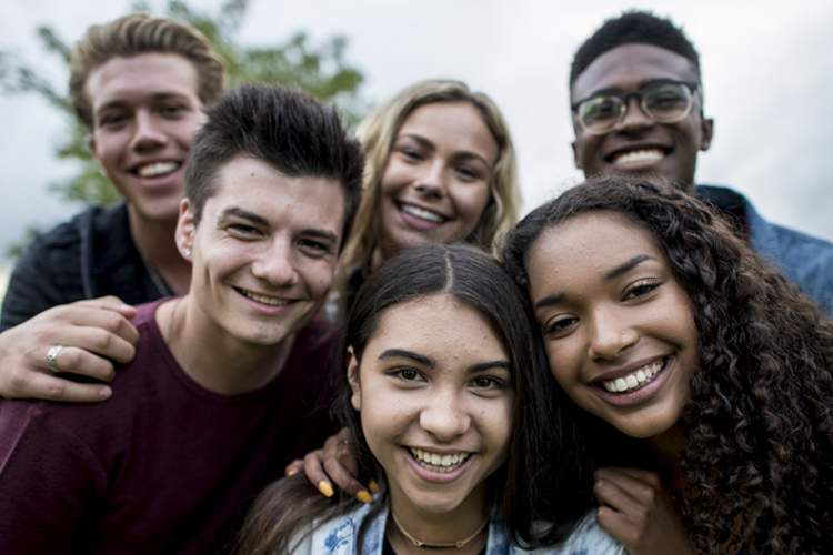 Smiling group of teens.