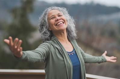 Smiling senior woman practicing mindfulness technique.