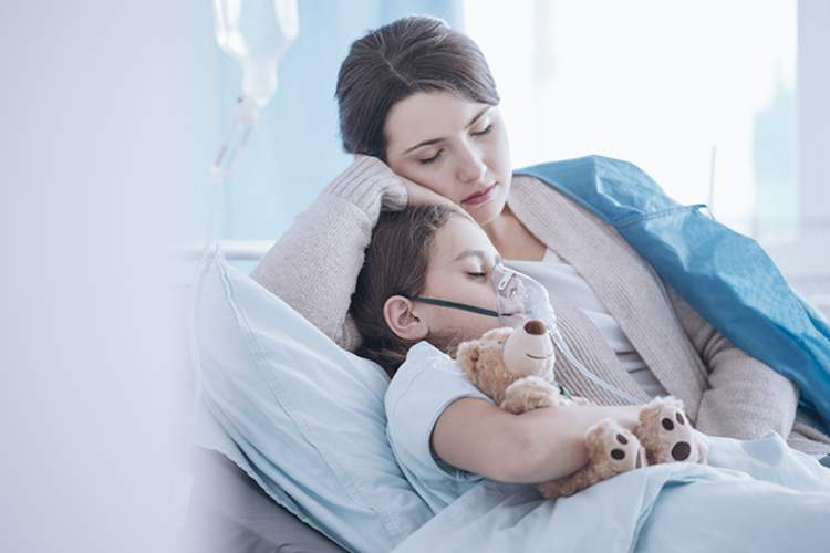 Child with asthma in the hospital with mother.
