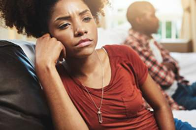 A young woman looks frustrated.