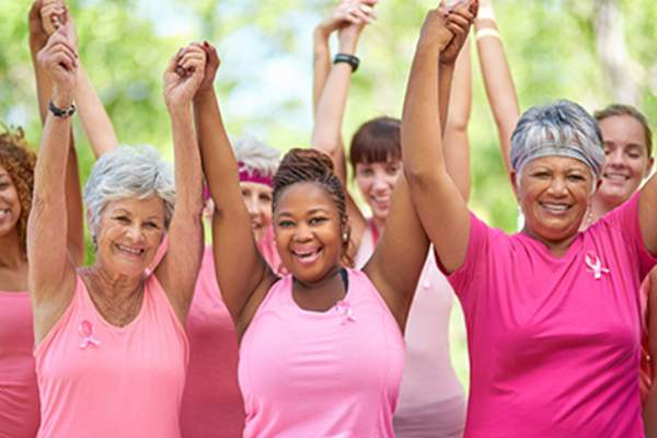 Group of joyous breast cancer survivors.