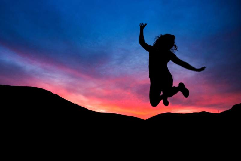 silhouette of woman jumping in the air