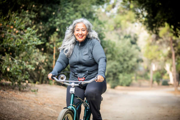 senior overweight woman on bicycle
