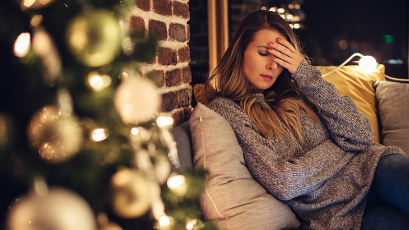 Woman battling depression during Christmas time.
