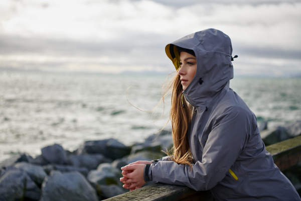 Young woman wearing jacket on waterfront