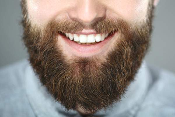 Bearded man smiling.