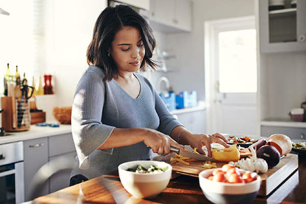 Woman cooking a healthy meal.